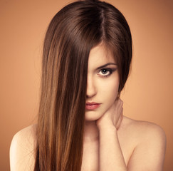 Hair care. Portrait of teenage girl with shiny healthy hair