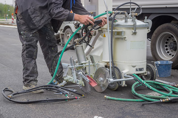 preparing paint machine for marking new road lines