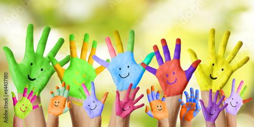 canvas print picture lachende bunt bemalte Kinderhände