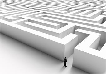 Tiny man entering a mysterious labyrinth