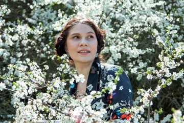 The girl in a spring garden.