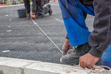 Road workers chalking