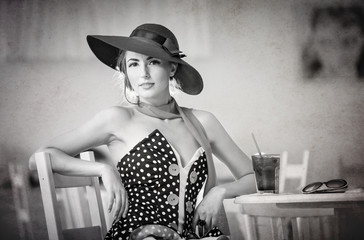 Fashionable attractive lady with hat and scarf in restaurant