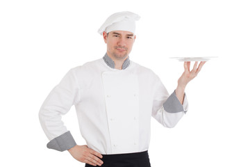 Young chef holding empty plate