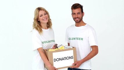 Team of volunteers holding donation box