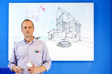 Architect in front of white board