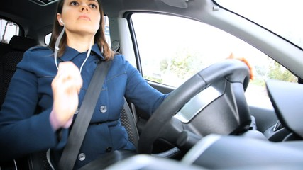 Woman starting engine of car driving
