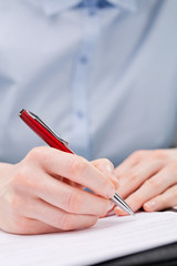 Business Hand Writing or Signing a Document