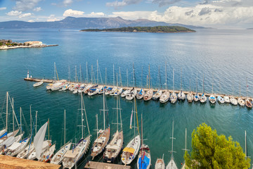 Aerial view to pier with yachts and boats