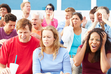 Disappointed Spectators At Outdoor Sports Event