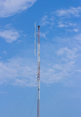 Telecommunication signal tower on blue sky