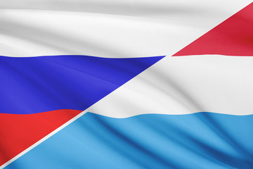Series of ruffled flags. Russia and Grand Duchy of Luxembourg.