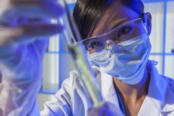 Chinese Woman Scientist With Test Tube in Laboratory