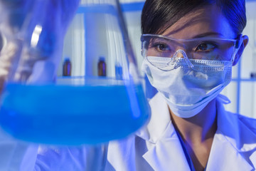 Chinese Female Woman Scientist Blue Flask In Laboratory