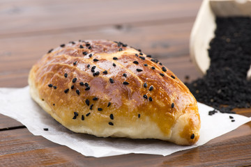 Turkish pastry with black cumin seeds called pogaca