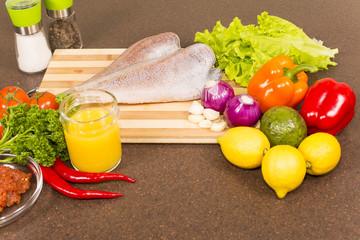 brotola raw fish with fresh vegetables