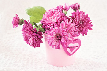 purple chrysanthemum flowers in a pot decorated with a heart
