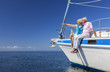 Happy Senior Couple Sailing on a Sail Boat - 64446326