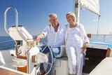 Happy Senior Couple Sailing Yacht or Sail Boat