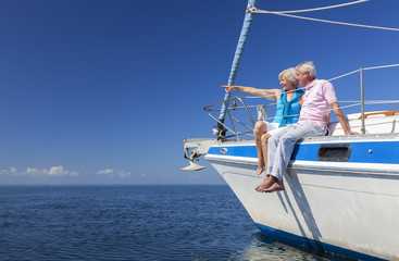 Happy Senior Couple Sailing on a Sail Boat