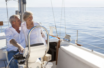Happy Senior Couple Sailing Yacht or Sail Boat