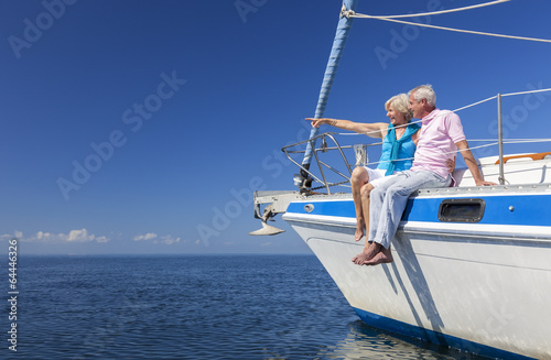 Leinwanddruck Bild Happy Senior Couple Sailing on a Sail Boat