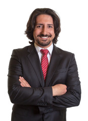 Standing turkish businessman with beard and crossed arms
