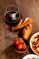 Lunch with wine, olives, tomatoes and bread