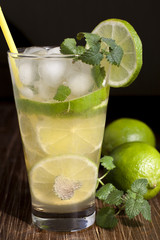 Mojito with fruit lime, mint leaves and ice.