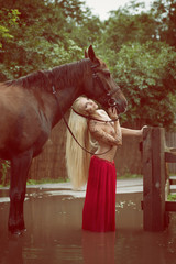 A young girl and a horse on nature