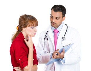 Doctor explaining treatment plan to sick female patient