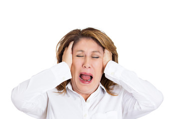 headshot woman having headache screaming on white background