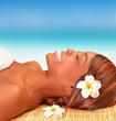Happy woman on spa resort