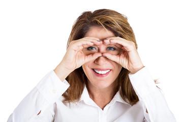 Happy curious woman observing looking through binoculars