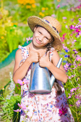girl posing with metal watering can shows thumb up