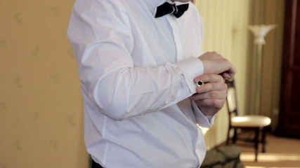 fashion man wears white shirt and cufflinks