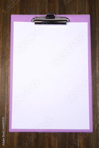 Clipboard on wooden background