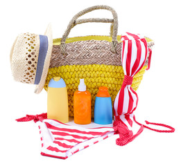 Wicker bag and swimsuit, isolated on white