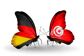 Two butterflies with flags  Germany and Tunisia