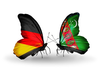 Two butterflies with flags  Germany and Turkmenistan