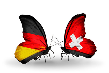 Two butterflies with flags  Germany and Switzerland
