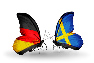 Two butterflies with flags Germany and Sweden