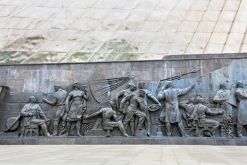 Wall of the monument with bas-relief