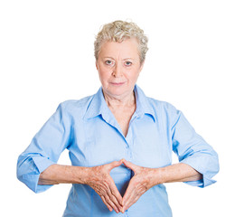 Senior woman with hand leader gesture on white background