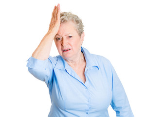 Duh moment. Old woman with hand on head, realization of mistake