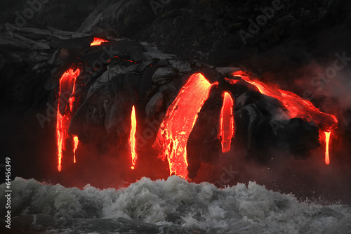 Red hot lava flowing into Pacific Ocean on Big Island, Hawaii - 64456349