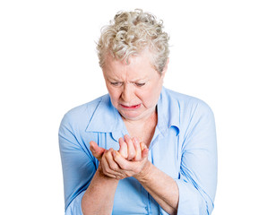 Senior, elderly woman having hand pain, arthritis