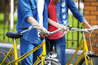 Young couple with bicycles outside
