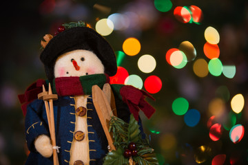 Snowman Doll with Skis and Christmas Lights