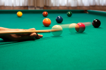 Shooting pool at a bar - Close-up shot of a man playing billiard